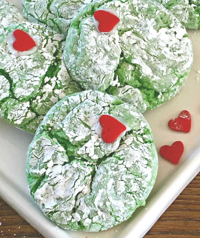 bright green grinch cookies with red candy heart