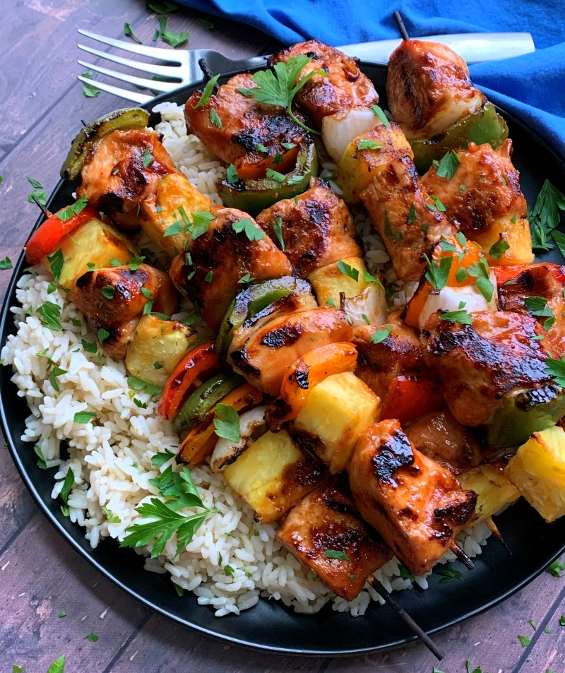 plate of hawaiian chicken kabobs and rice