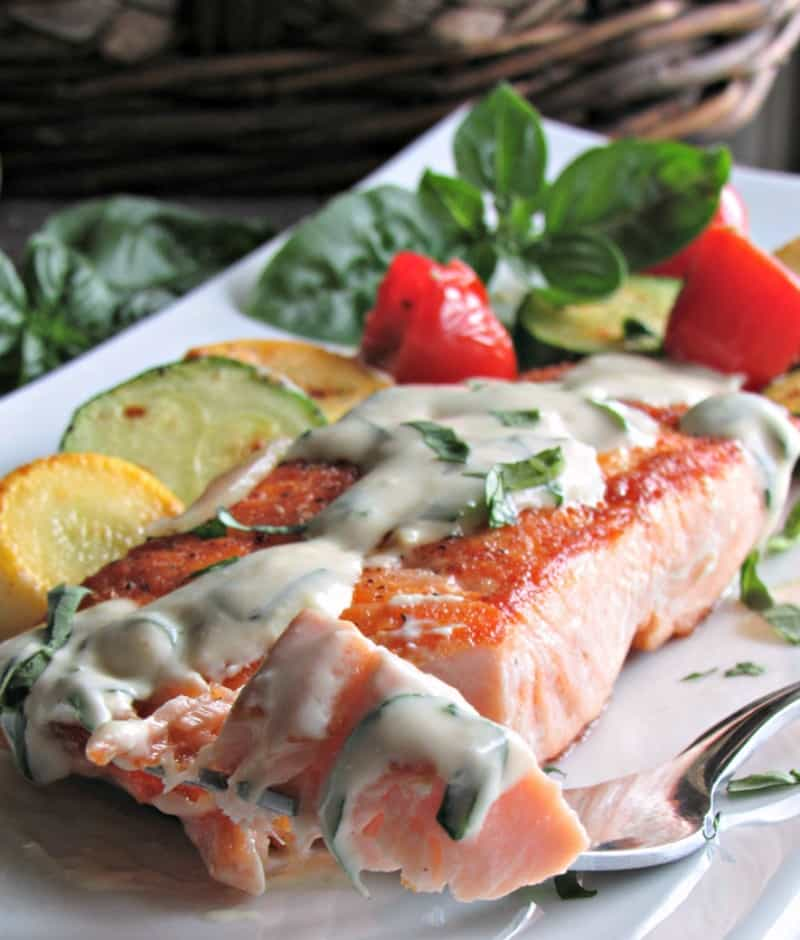 Creamy Honey Mustard Salmon: crispy pan-seared salmon topped with light, creamy sweet-tangy herbed honey mustard sauce goes stove to table in 20 minutes.