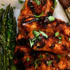 grilled chicken breasts with honey sriracha glaze and a side of grilled asparagus