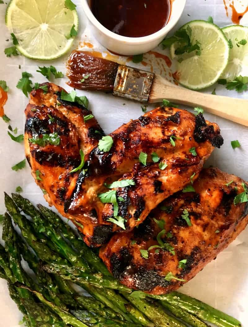 close up of grilled chicken breasts with honey sriracha glaze