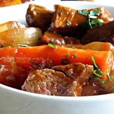 Irish Guinness Beef Stew: chunks of tender, seared beef, potatoes, onions and carrots in a thick, stew made more robust with the addition of Guinness beer.