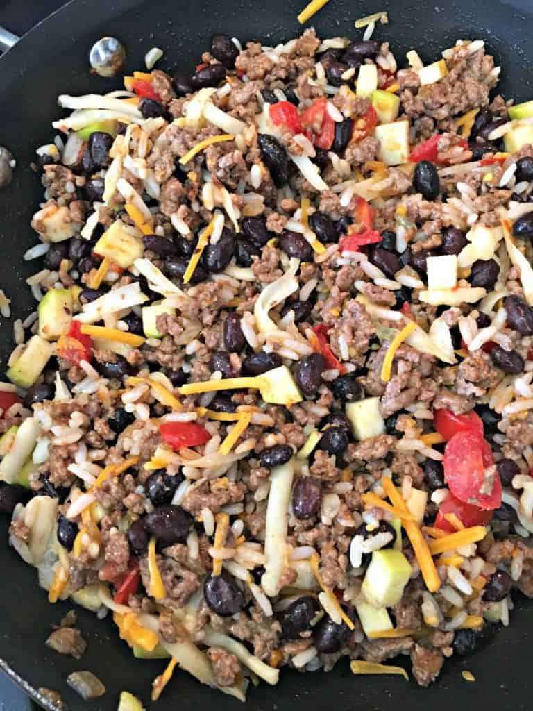 Mexican Stuffed Peppers ~ seasoned ground beef, rice and black beans baked in colorful bell peppers and topped with cheese.