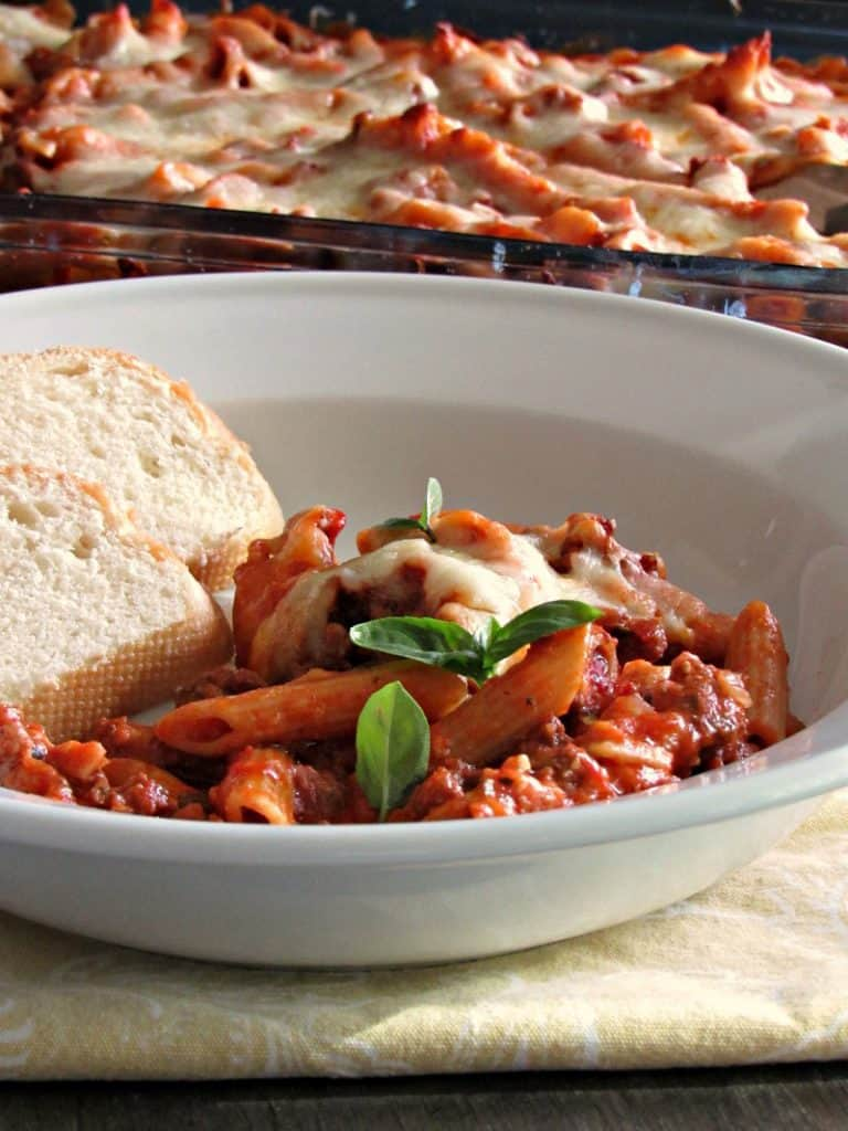 Baked Mostaccioli ~ blanketed in layers of robust tomato flavor, 3 cheeses and baked. Easy prep and a great dish for a crowd.