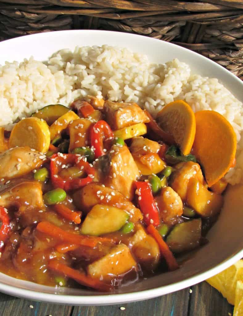 Orange Chicken ~ buried in fresh orange flavor and sautéed vegetables instead of breading for an easy weeknight under 30 minute meal.