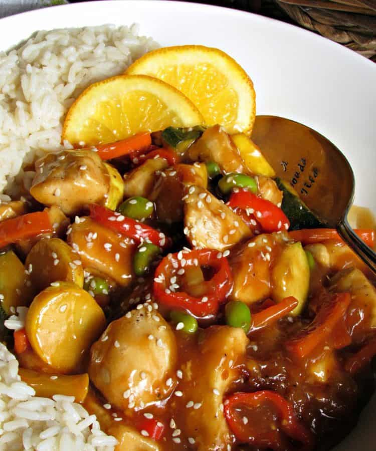 Honey Orange Chicken ~ a lighter version with fresh citrus flavor, sautéed vegetables, tender bites of chicken without heavy breading = an easy under-30 minute meal.