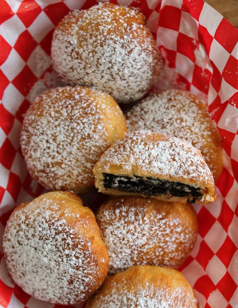 Air fryer fried oreos in basket lined with red and white checked paper
