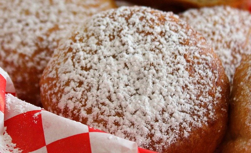 Red basket with fried oreos dusted with powdered sugar
