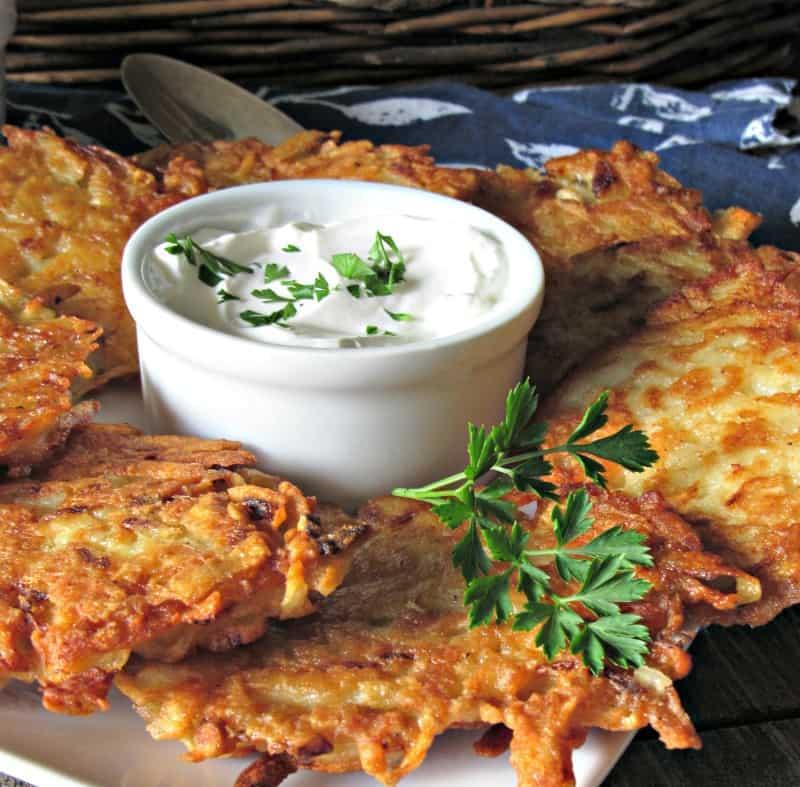 Crispy Potato Pancakes ~ crispy outside with tender shredded potatoes inside. Serve with applesauce or sour cream. Eastern European tradition.