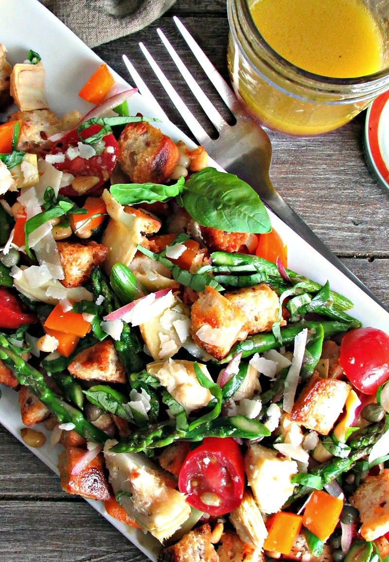 Spring Panzanella Salad ~ golden, toasted whole grain bread cubes, fresh asparagus, tomatoes, artichokes + other seasonal vegetables lightly dressed in an easy homemade red wine vinaigrette.