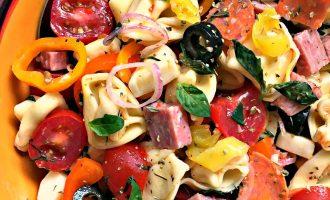 italian pasta salad ~ tortellini antipasto salad overhead view in colorful bowl