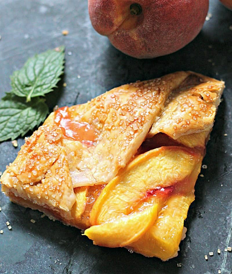 Peach galette recipe ~ slice of peach galette topped with coarse sugar and baked until golden.