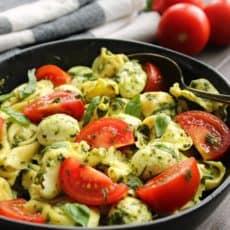 tortellini, sliced tomatoes and mozzarella balls tossed in pesto