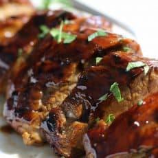 sliced pork roast with honey balsamic glaze