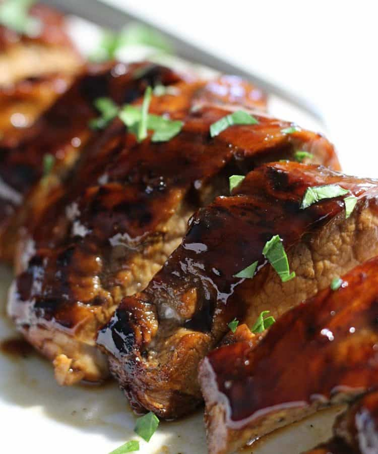 sliced pork roast with honey balsamic glaze