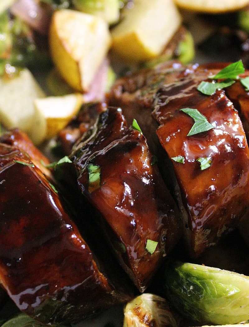 sliced, pork drizzled with honey balsamic glaze
