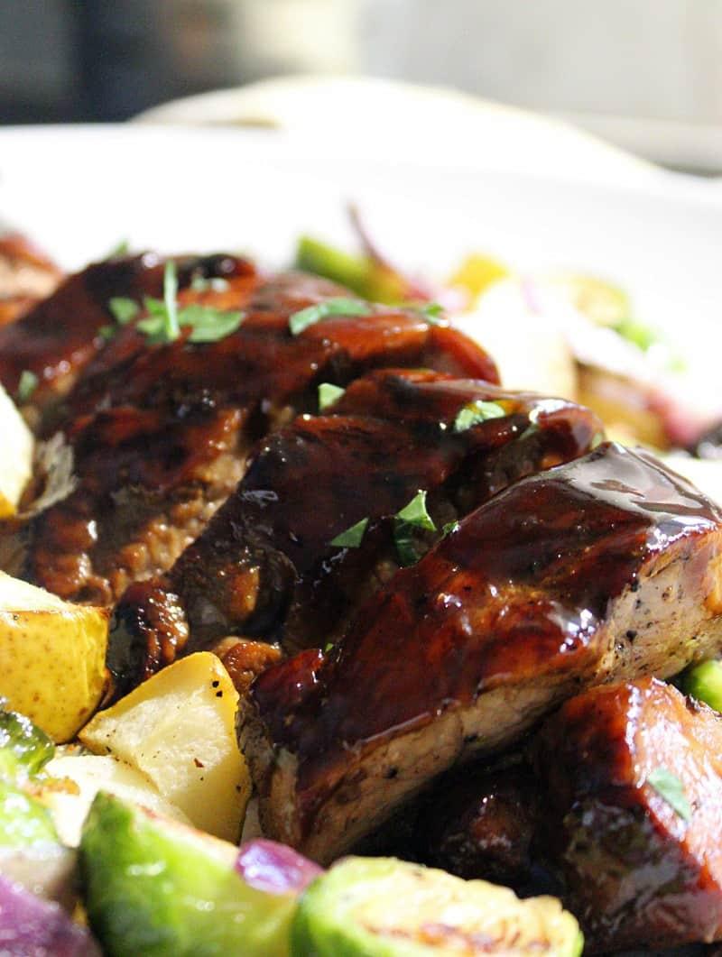 sliced pork tenderloin alongside brussels sprouts, cubed potato medley