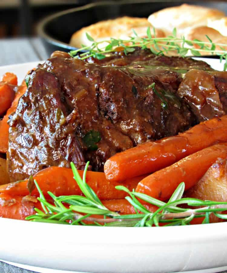 Classic Pot Roast ~ slow-cooked, melt-in-your-mouth roast beef, braised potatoes and bright colored carrots in a rich 5-star gravy.