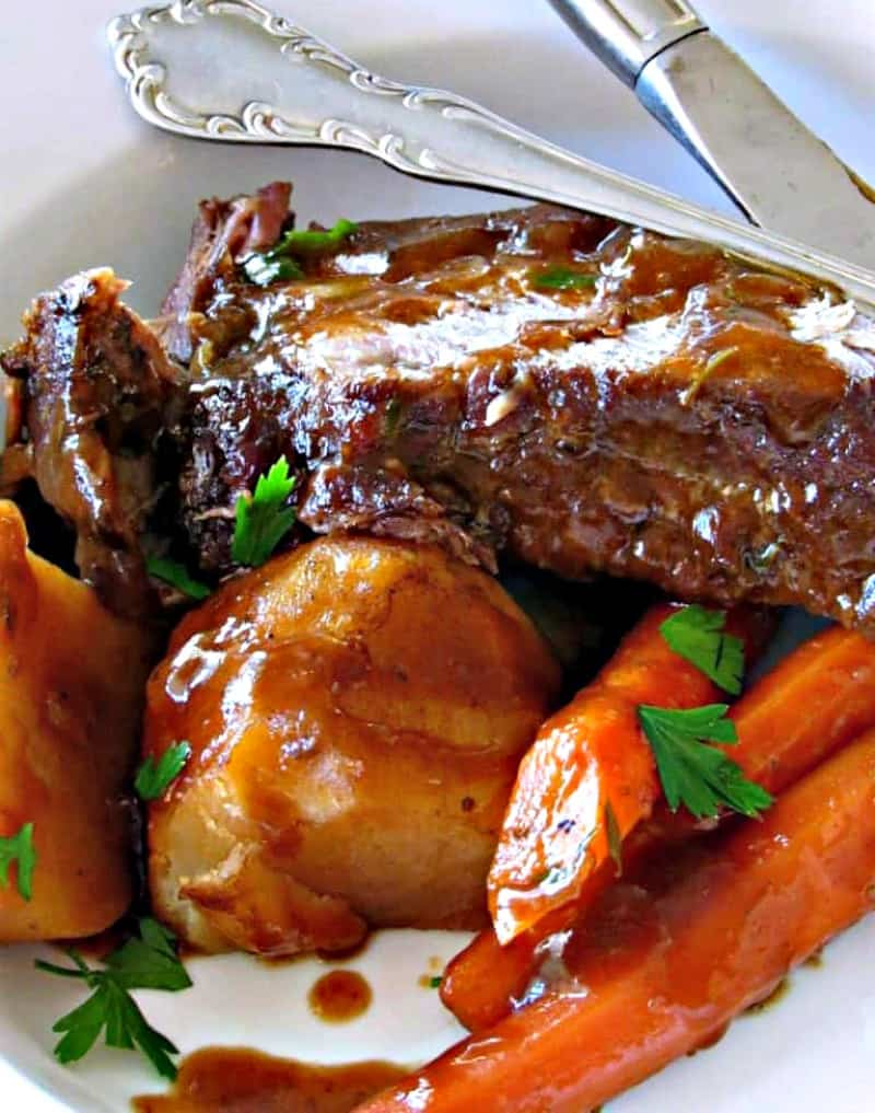 serving of pot roast with carrots, potatoes and gravy