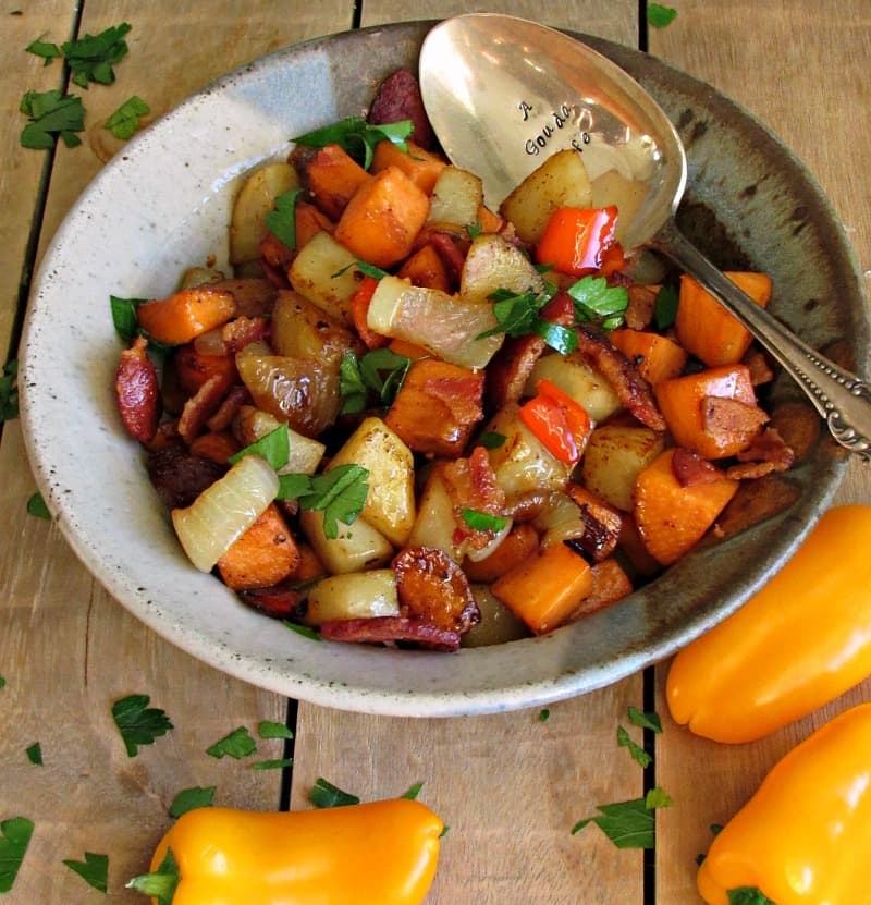 Bacon Sweet Potato Hash: diced sweet and russet potatoes cooked until tender and browned, crispy bacon and a slight tang from apple cider vinegar.