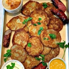 baking sheet with golden potato pancakes garnished with parsley