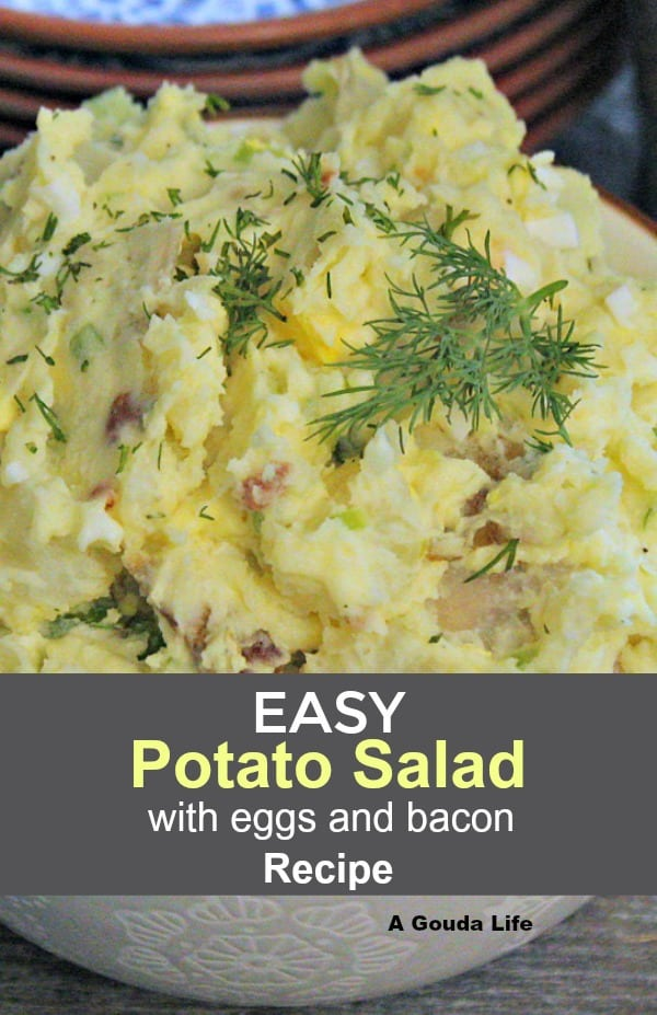 potato salad recipe with bacon and hard boiled eggs garnished with dill