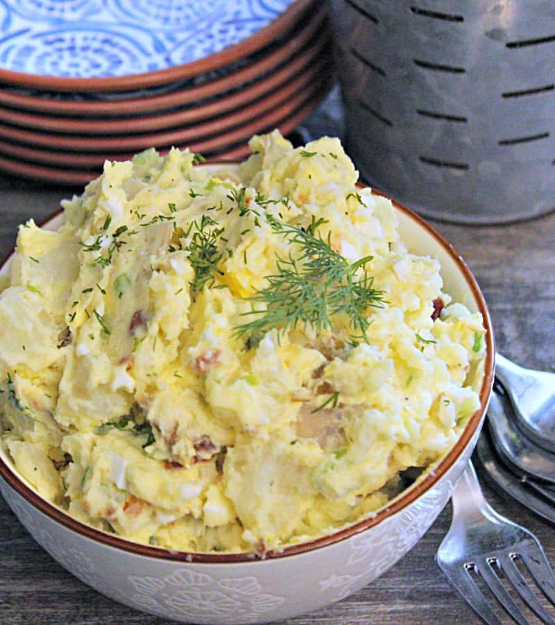 potato salad recipe - overview view of blended potato salad garnished with dill