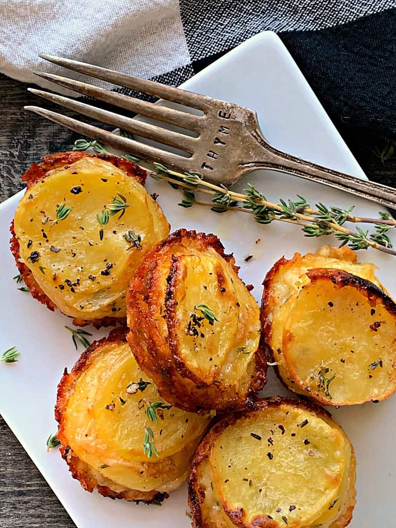 Muffin Tin Potato Stacks with Gouda Cheese. Thinly sliced potatoes layered with onions and smoked gouda cheese baked in muffin tins until tender inside with crispy golden edges outside.