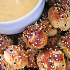 easy soft pretzel bites with everything bagel seasoning served with a bowl of cheese sauce