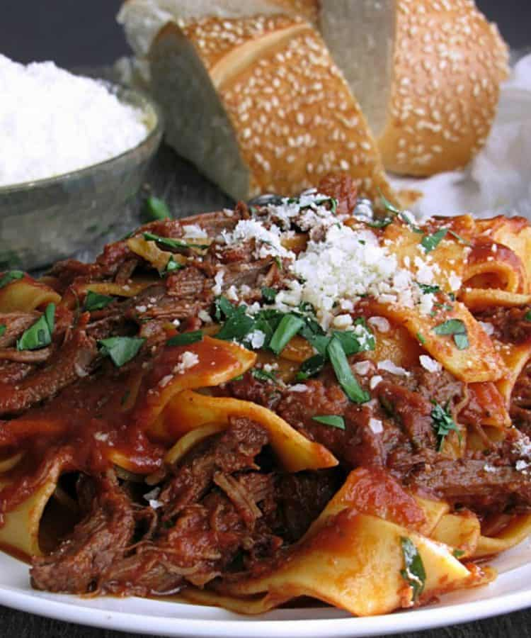 braised beef ragu over pappardelle pasta sprinkled lightly with parmesan cheese and fresh parsley