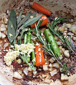 celery, carrots, onions and herbs sauteing for braised beef ragu