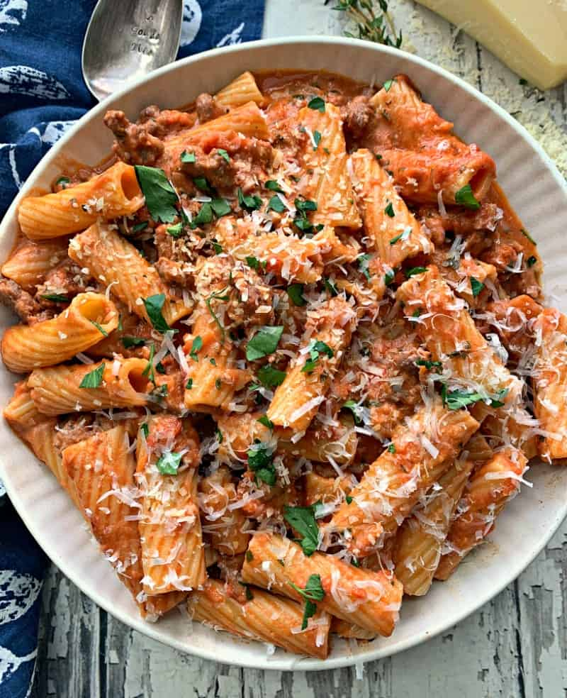 overhead view of sausage rigatoni garnished with parsley