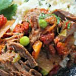 slow cooker ropa vieja with a side of white rice and black beans