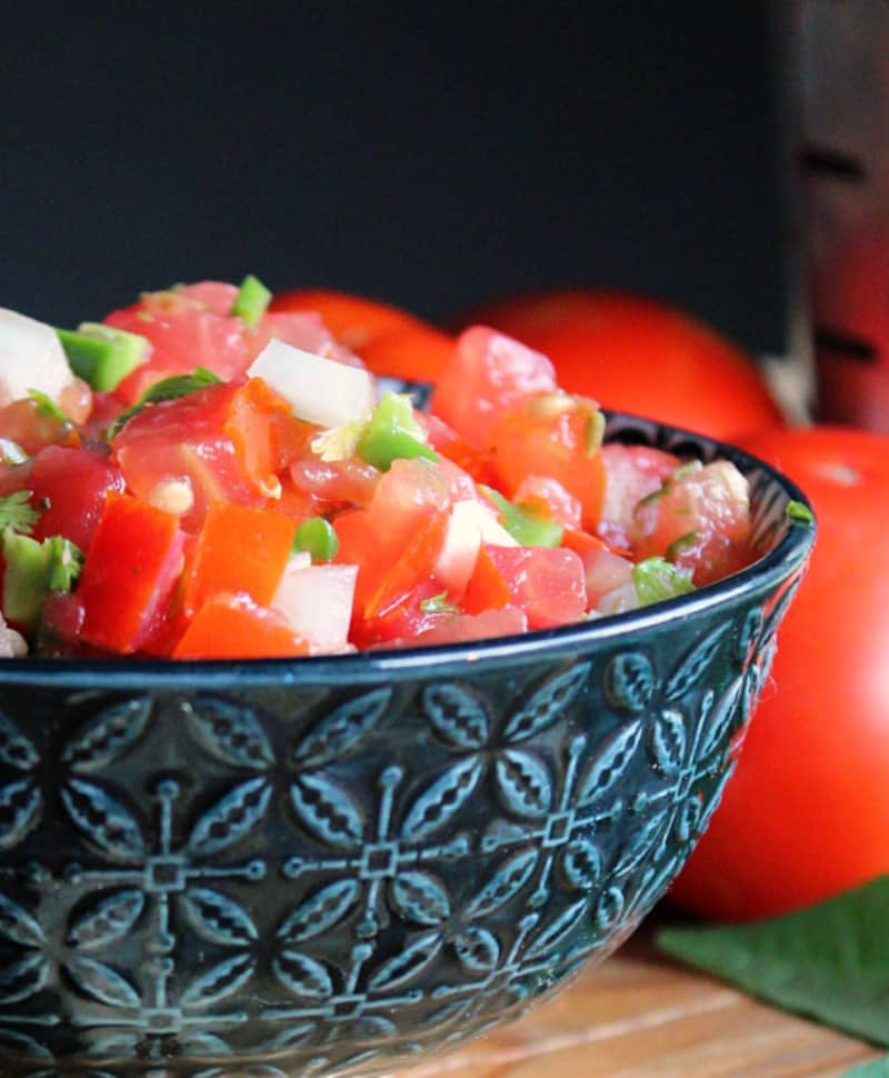 fresh tomato salsa ~ no cook recipe, diced tomatoes, jalapeno, onions, cilantro and lime. Tasty appetizer or top any Mexican dish.