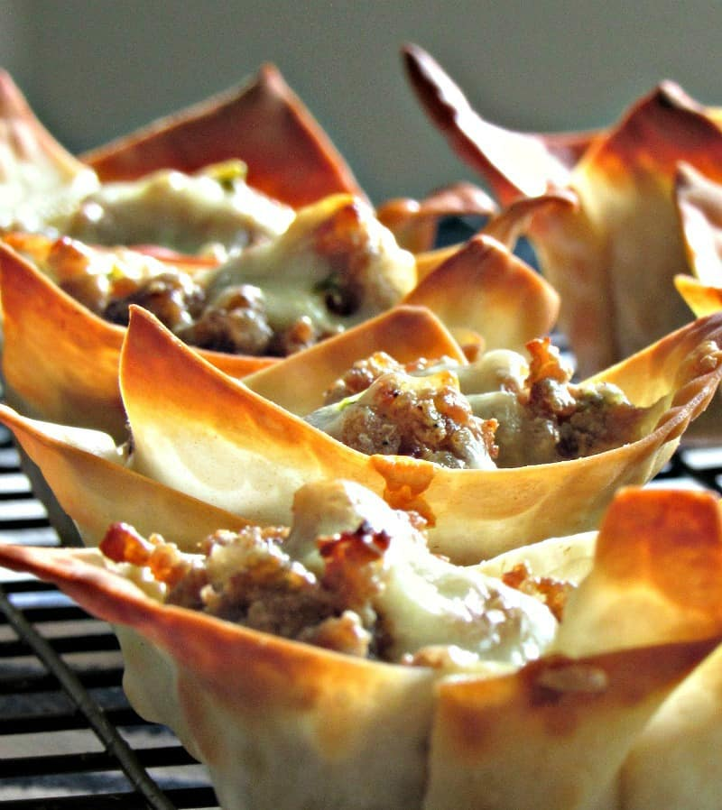 bite size wonton cups filled with sausage and cheese