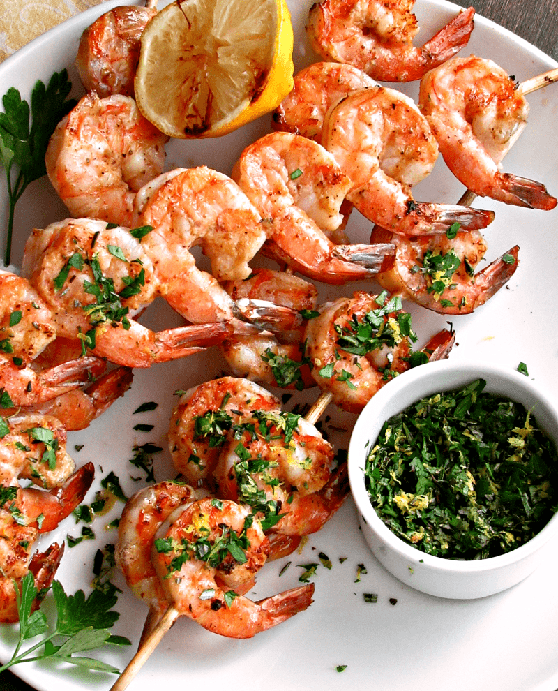 Grilled Shrimp Scampi: a twist on the classic-fresh shrimp grilled basted in rich, buttery-garlic white wine sauce, topped with fresh mixed herb gremolata.