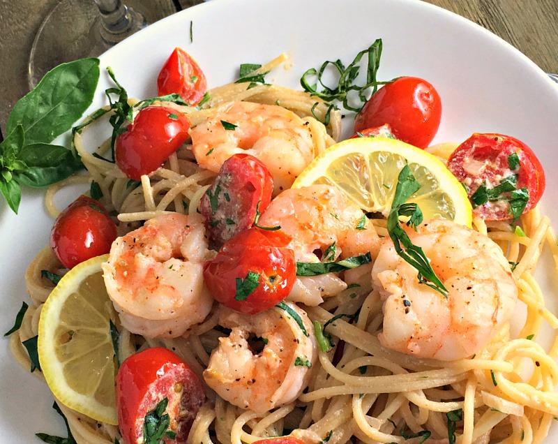 Light, slightly lemony creamy shrimp pasta with NO heavy cream. Great summer dish!