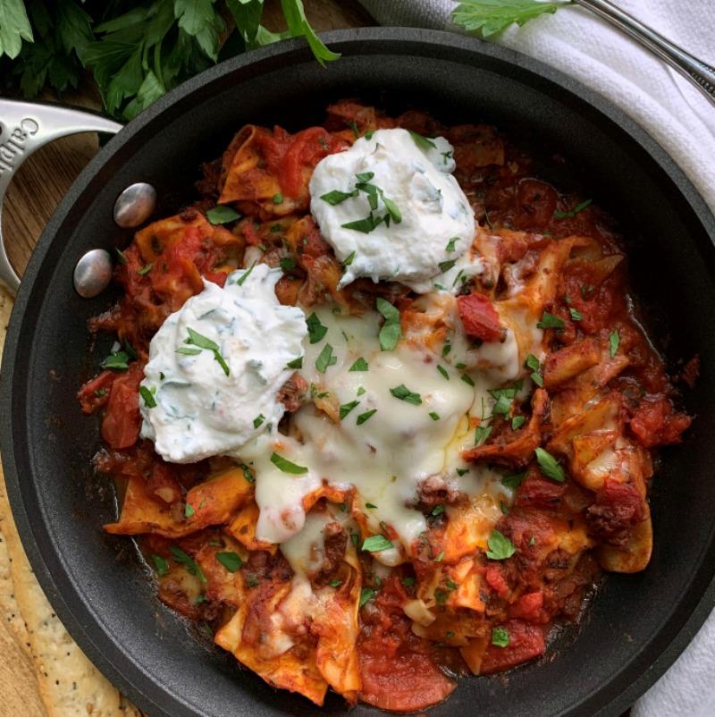 pan of skillet lasagna with dollops of ricotta