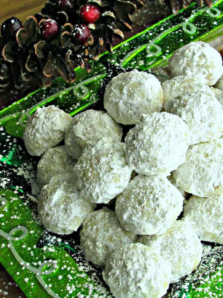 Snowball Christmas Cookies, sometimes known as Russian Tea Cakes, Butterball Cookies or Mexican Wedding Cookies. Nutty, buttery, melt-in-your-mouth shortbread lightly dusted with confectioners sugar. A holiday must!