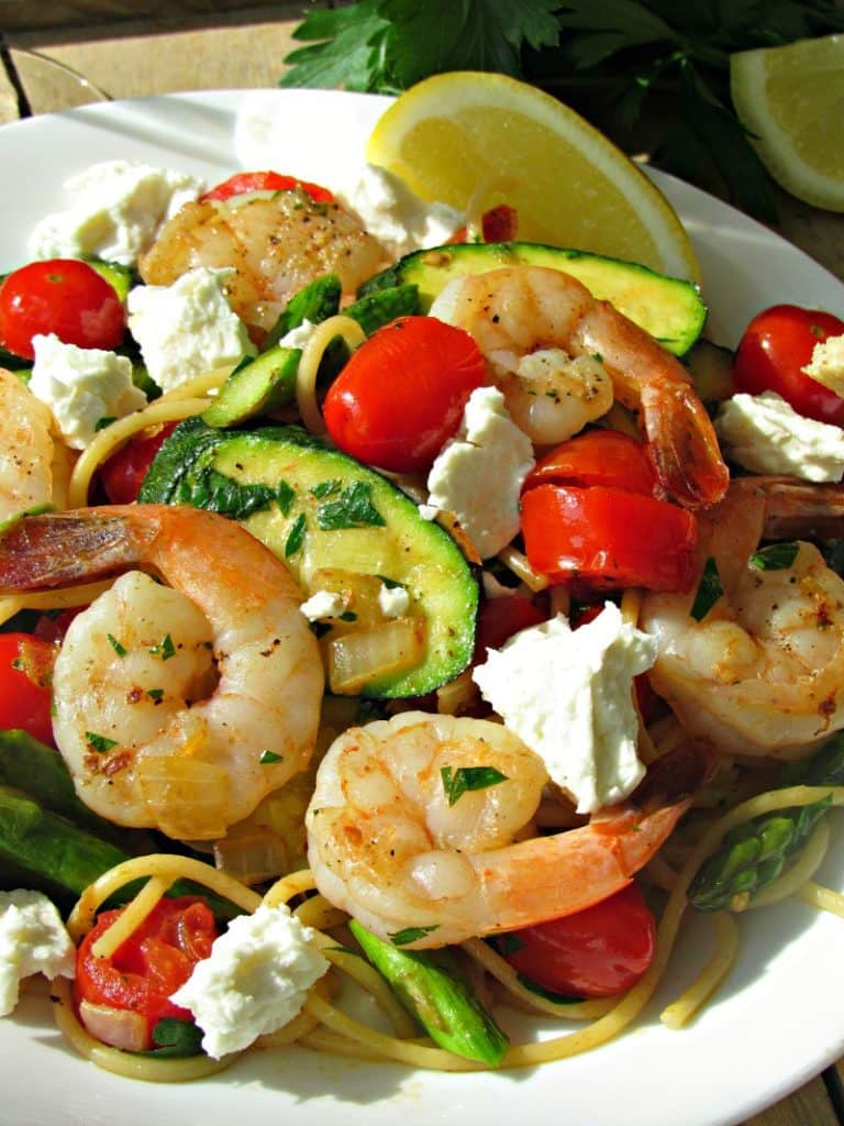 Lemon Vegetable Spring Pasta ~ sauteed vegetables and pasta dressed in a light, lemon-olive oil sauce, topped with feta cheese for an easy any night meal.