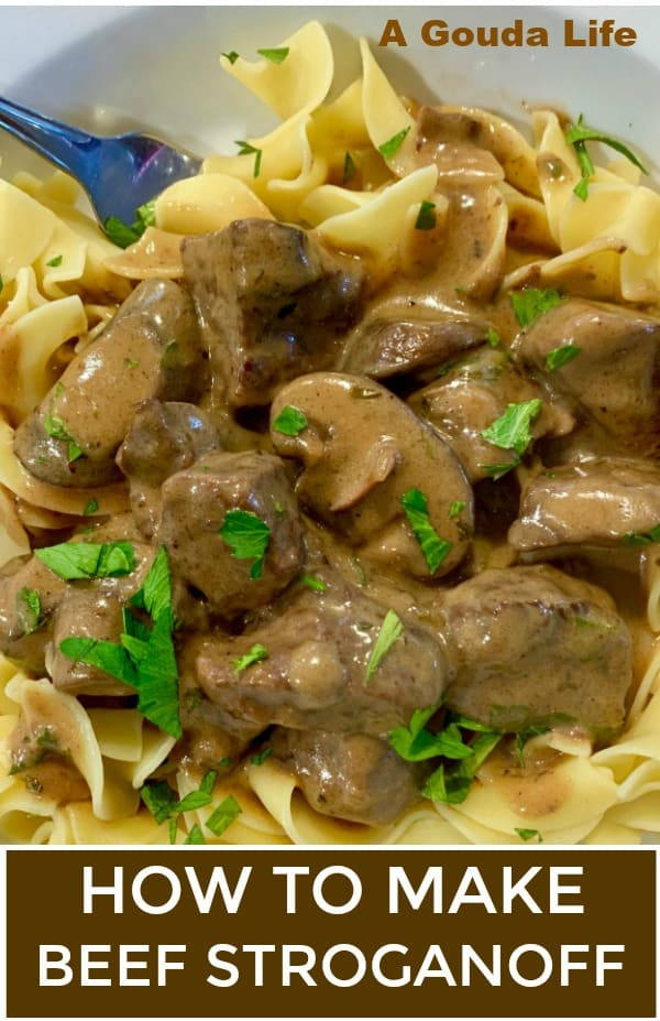 pinterest pin with closeup of stroganoff over noodles garnished with parsley