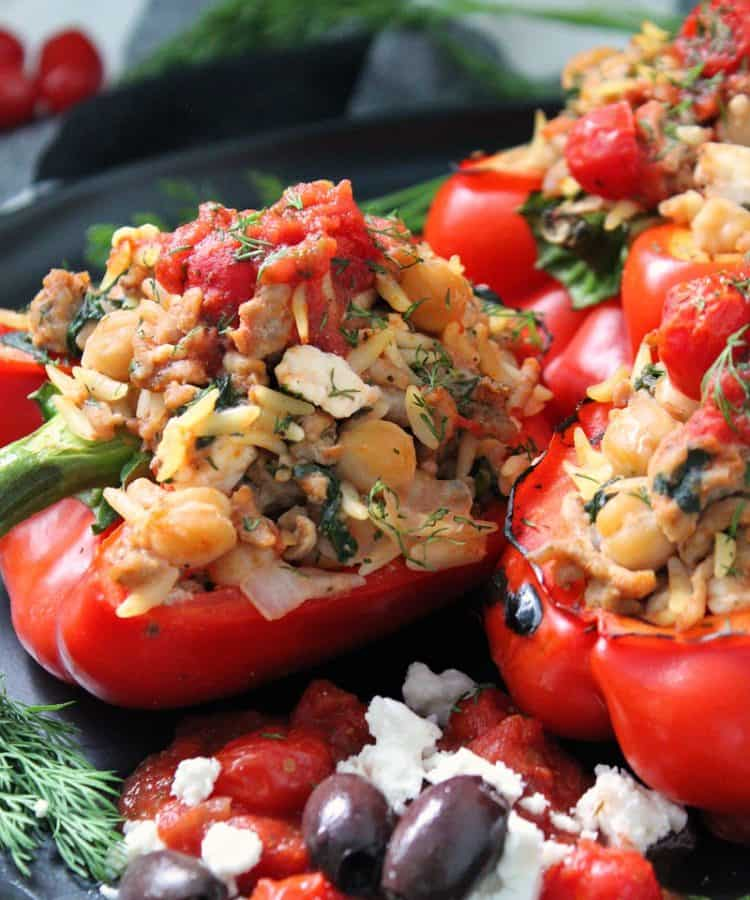 greek stuffed peppers ~ red bell peppers filled with greek seasoned ground turkey, feta, orzo, spinach and chickpeas baked in a Greek flavored tomato-herb sauce.