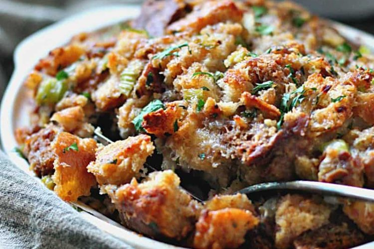 baking dish piled high with bread sausage stuffing