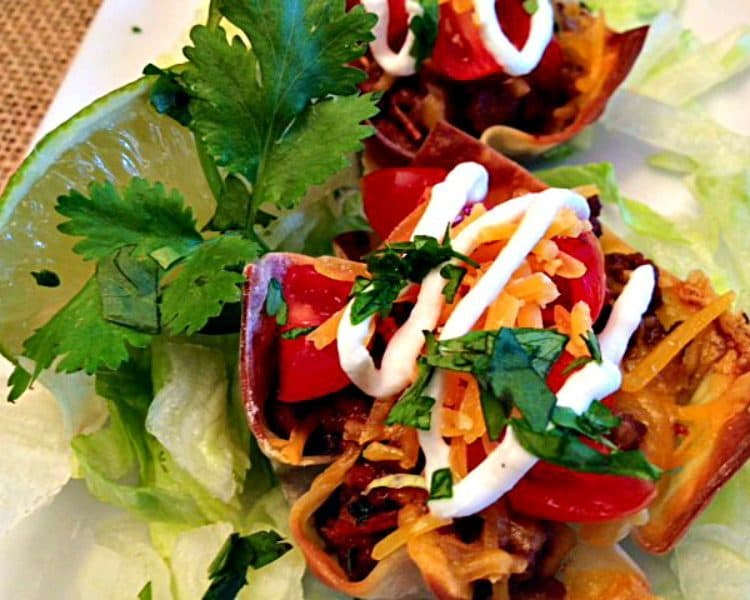 Taco Cupcakes: wontons filled with spicy ground beef topped with cheese, lettuce, tomatoes and everything you love on a taco all baked in mini muffin tins.