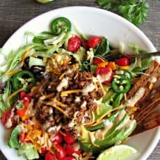 healthy taco salad ~ overhead view of salad with dressing