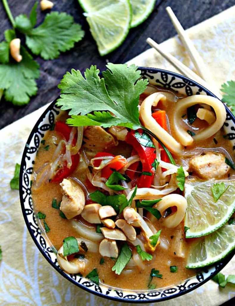 pad thai soup garnished with cilantro and lime