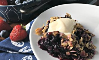 Triple Berry Crisp - fresh summer berries with a crumbly oatmeal topping and a dollop of whipped ricotta flavored with honey and vanilla.