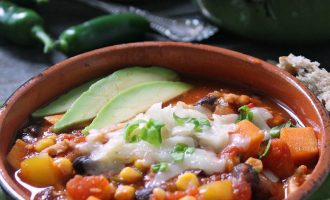 turkey sweet potato chili ~ garnished with sliced avocado, includes black beans and corn.