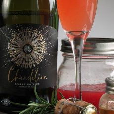 watermelon sparkling wine cocktail ~ chandelier sparkling wine with jar of watermelon juice and cocktail in champagne flute