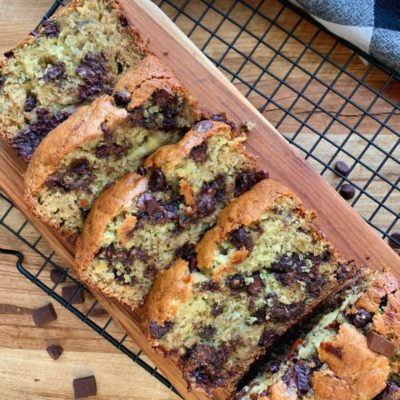 sliced zucchini banana bread with chocolate chips on cutting board